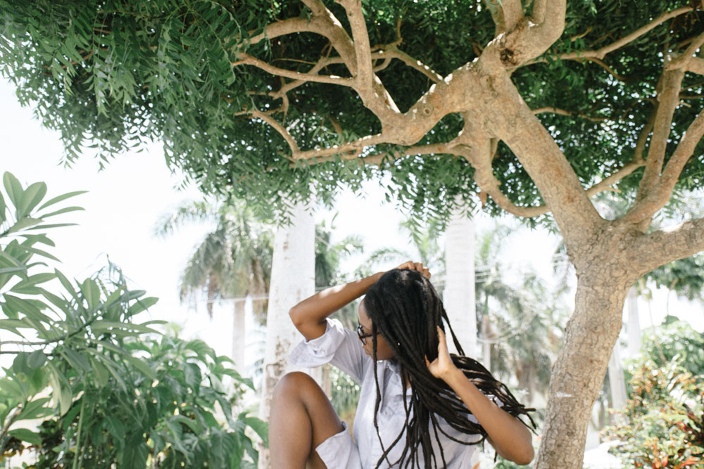 The Au Courant Daily Journal | A Calm, Caribbean take on Dreadlocs and Hair Rituals in the Sun